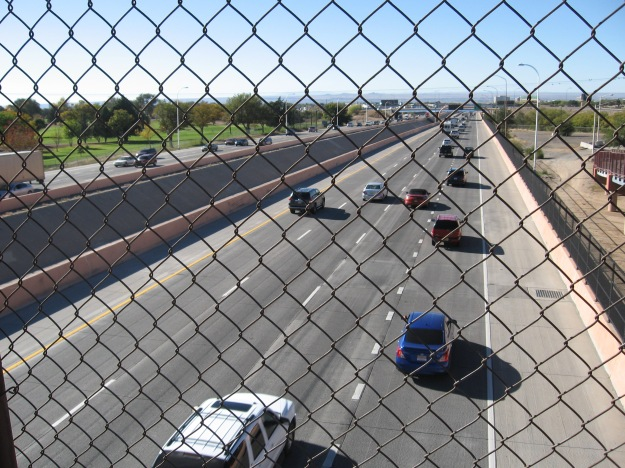 looking west from the I-40 bike bridge.  Those three little bumps on the West Mesa are the volcanoes in Petroglyph National Monument