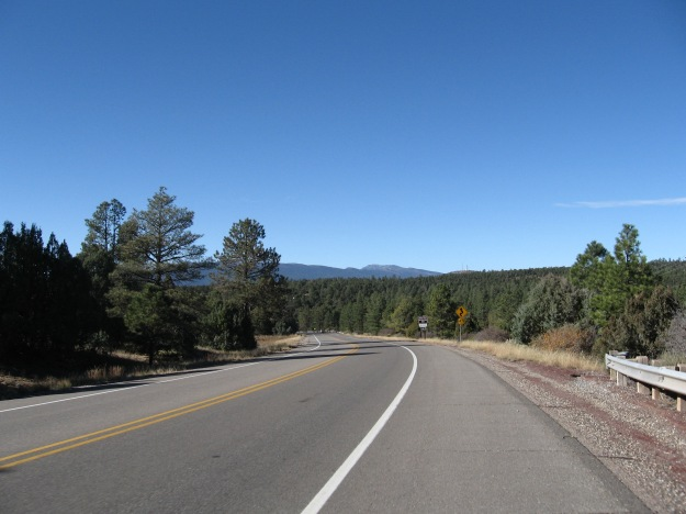 The descent has spectacular views of Cedro Peak (nearest w/ antennas on top) and the distant Sandia range