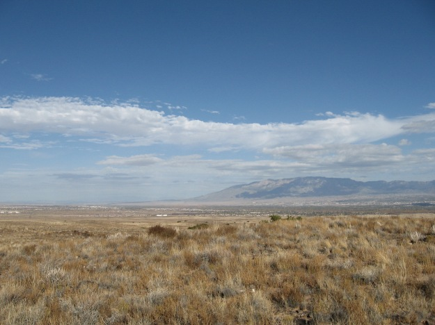 the north shoulder of the Sandia opens to the big country rolling around the river