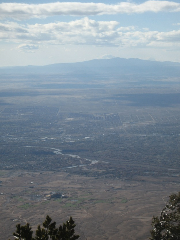 looking west from the Crest with Sandia Casino and golf in foreground, river in middle, and Mt. Taylor (San Mateo Mtns) on horizon.
