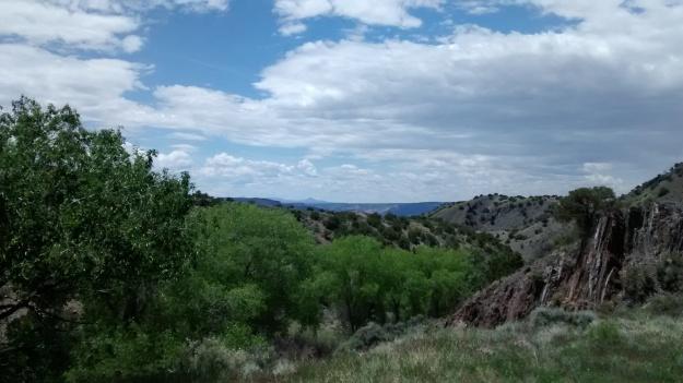 Cerro Pedernal and the Jemez in the distance above Embudo Creek near Picuris Pueblo on the road to Dixon