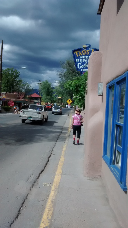 Taos sidewalk walking the narrow