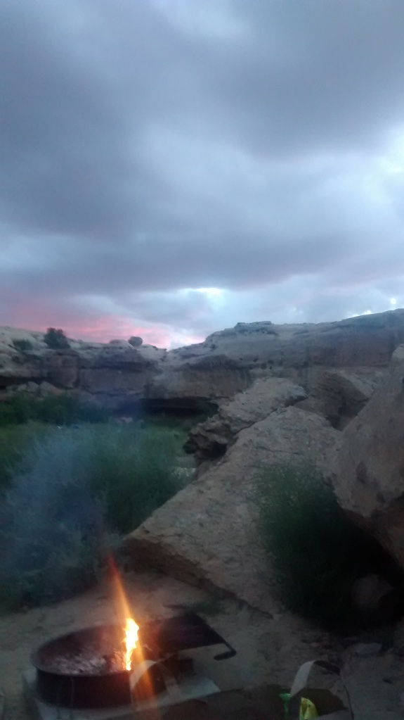 campfire amongst rocks and sky